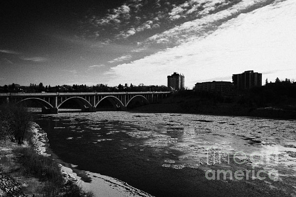Downtown Photograph - large chunks of floating ice on the south saskatchewan river in winter flowing through downtown Sask by Joe Fox