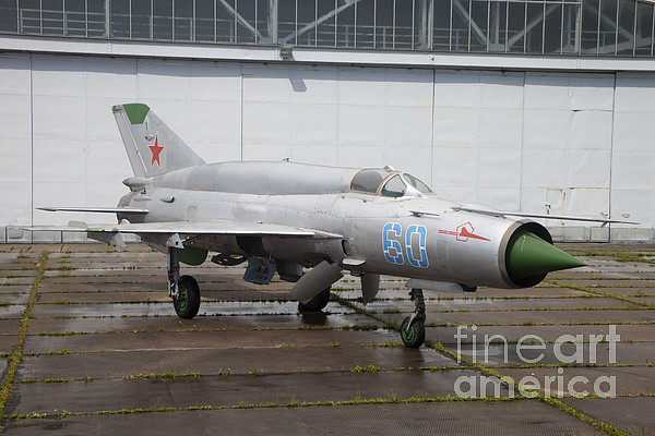 Germany Photograph - A Russian Mig-21smt Fighter Plane by Timm Ziegenthaler