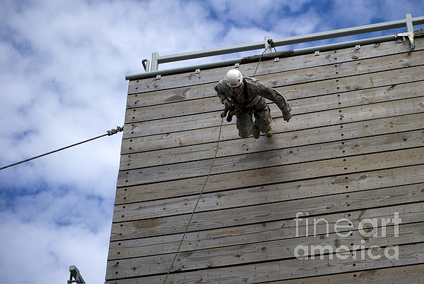 Soldier Photograph - A U.s. Soldier Runs Down A 40-foot by Stocktrek Images