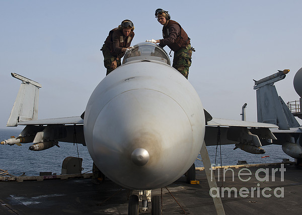 Military Photograph - Airmen Clean The Canopy Of An Fa-18f by Stocktrek Images