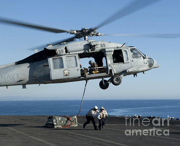Military Photograph - An Mh-60s Sea Hawk Helicopter Prepares by Stocktrek Images