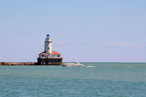 Chicago Photograph - Chicago Light House With Boat In Lake Michigan by Christine Till