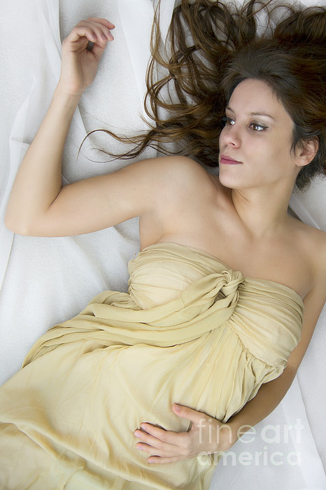 Caucasian; Woman; Lady; Female; Brunette; Beautiful; Elegant; Lovely; Dark Hair; 20s; White; Laying; Sheets; Bed; Fair; Prim; Proper; Feminine; Brown Eyes; Close Up; Gold; Dress; Strapless Photograph - Gold by Margie Hurwich