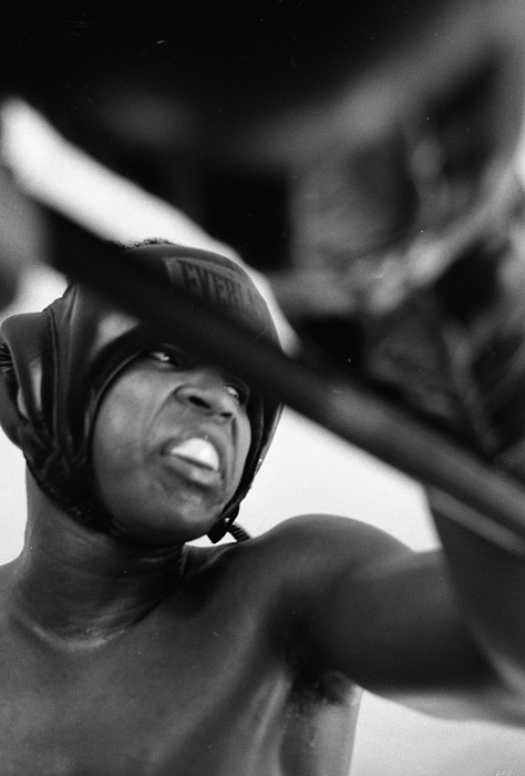 Marvin Newman Photograph - Muhammad Ali Looking Sideway Through Rope by Retro Images Archive