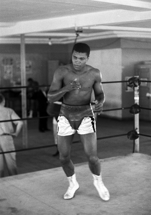 Marvin Newman Photograph - Muhammad Ali Warming Up by Retro Images Archive