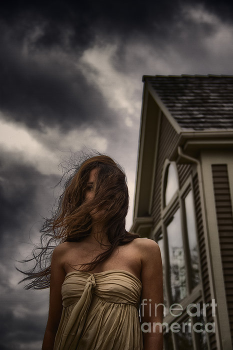 Caucasian; Woman; Lady; Female; Outside; Outdoors; Storm; Stormy; Clouds; Dark; Ominous; Wind; Windy; House; Home; Horror; Scary; Mysterious; Mystery; Foreboding; Hair; Long Hair; Brunette; Dress; Gold; Strapless; Windows; Domineering; Haunted; Scared; Terror Photograph - Storm by Margie Hurwich