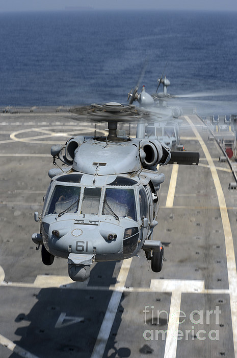 Military Photograph - Two Mh-60s Sea Hawk Helicopters Take by Stocktrek Images