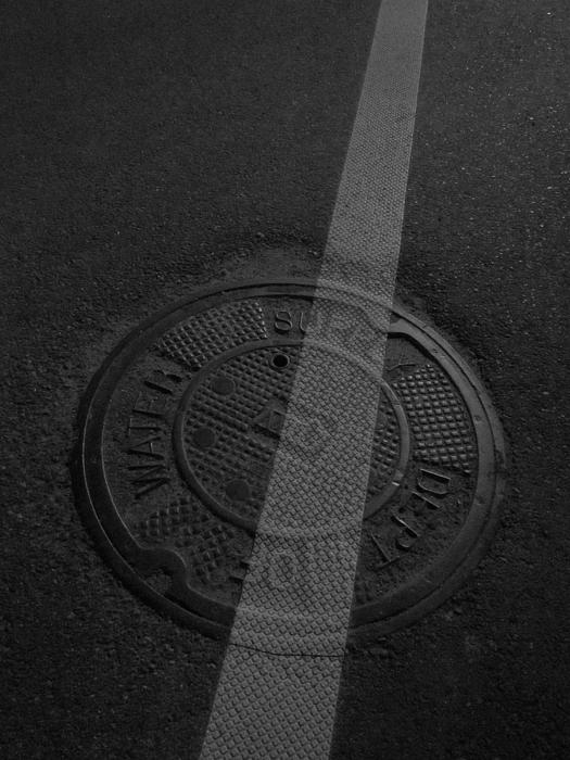 Guy Ricketts - White Stripe on Manhole Cover
