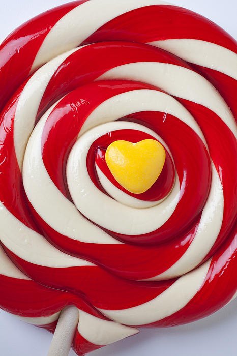 Candy Photograph - Yellow Candy Heart On Sucker by Garry Gay