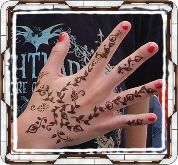 designing a tattoo. Henna Hand Design Painting