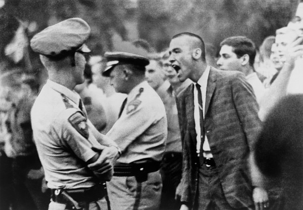 History Photograph - A White Student Shouts Insults by Everett