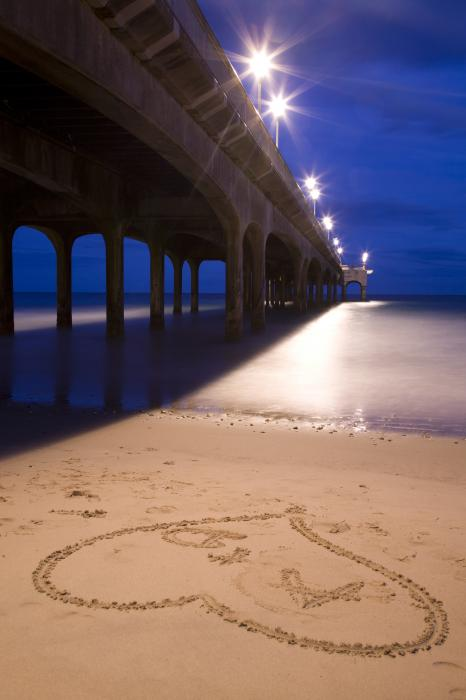 Love heart in the sand at Boscombe Pier Photograph - Love heart in the sand