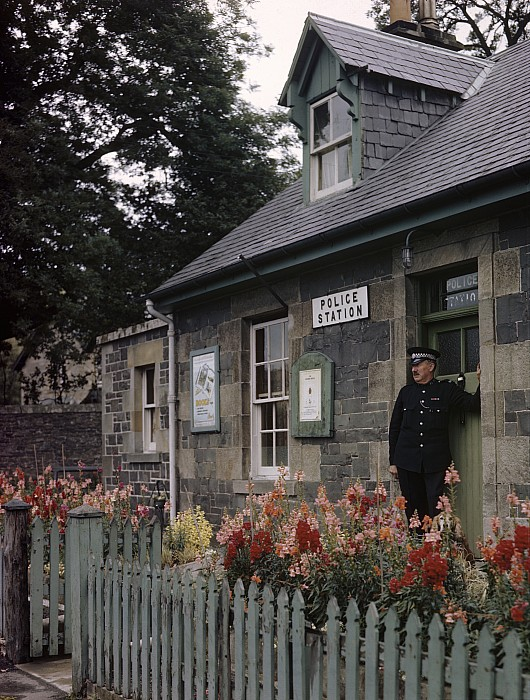 Outdoors Photograph - Policeman And Dog Stand At Police by B. Anthony Stewart