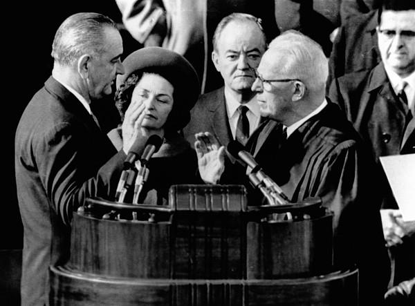 History Photograph - President Lyndon Johnson Takes The Oath by Everett
