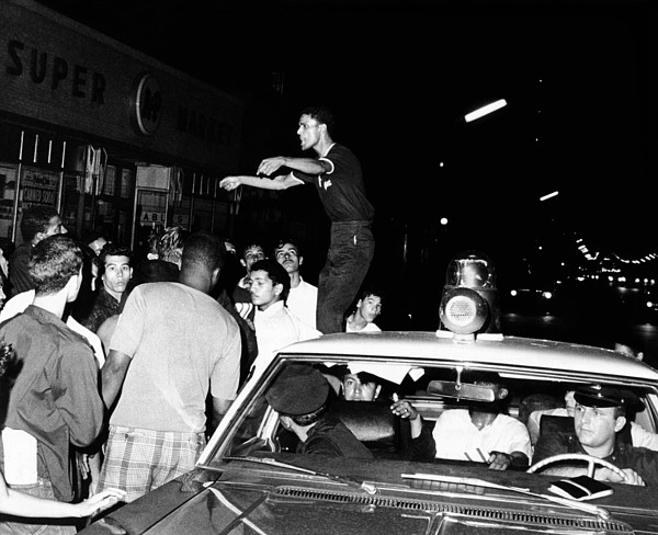 History Photograph - Puerto Rican Youth Standing On A Police by Everett