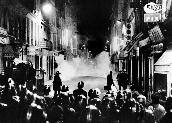 History Photograph - Riot Policemen At A Burning Barricade by Everett