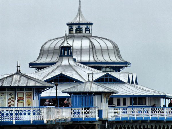 Lorainek Photographs - The pier stands proud
