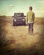 Sandra Cunningham - Man standing in front of car in field