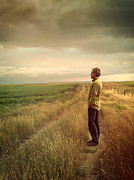 Sandra Cunningham - Man standing on Prairie looking out...