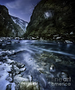 White River Scene Prints - A River Flowing Through The Snowy Print by Evgeny Kuklev