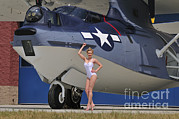 Pby Catalina Posters - Retro Pin-up Girl Posing With A World Poster by Christian Kieffer