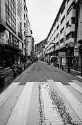 Crosswalk Framed Prints - Avinguda Meritxell Shopping Area Street In Andorra La Vella Andorra Framed Print by Joe Fox