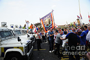 Law Enforcement Prints - Loyalist Protesters Attack Police Lines Print by Andrew Chittock