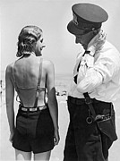 Bathing Photos - A Cop Polices Bathing Suits by Underwood Archives