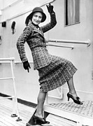Gestures Photo Framed Prints - A Lively Woman Boards A Ship Framed Print by Underwood Archives