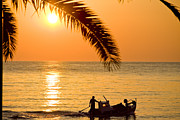 Sun Pyrography Framed Prints - Boat at sea Sunset golden color with palm Framed Print by Raimond Klavins