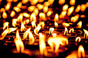 Milarepa Photos - candle light in Boudnath stupa by Raimond Klavins