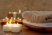 Spa Posters - Candles and Towels in a Spa Poster by Olivier Le Queinec