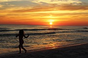 Vicki Kennedy Framed Prints - Child Running on Beach at Sunset Framed Print by Vicki Kennedy