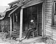 Poor People Photo Prints - Elderly Man Doses On His Porch Print by Underwood Archives