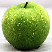 Kitchen Photos Posters - Green Apple Poster by John Rizzuto