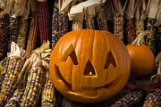 Jack O Lantern Photos - Jack-O-lantern and Indian corn  by Garry Gay