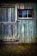 Sandra Cunningham - Old shed door with spooky shadow in...