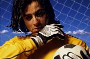 Ball And Glove Prints - Soccer Goalkeeper In Net Print by Don Hammond