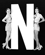 "Matching Outfits Framed Prints - The Letter ""N""  And Two Women Framed Print by Underwood Archives"