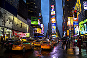 Advertisement Photo Posters - Times square in the rain Poster by Garry Gay