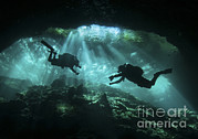Water In Cave Posters - Two Divers Silhouetted In Light Poster by Karen Doody