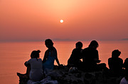 Santorini Photos - Watching the famous sunset in Oia by George Atsametakis
