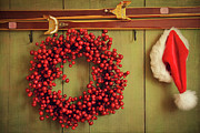 Wreath Art -  Red wreath with Santa hat hanging on rustic wall by Sandra Cunningham