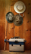 Sandra Cunningham - Hats hanging on wall with fishing...