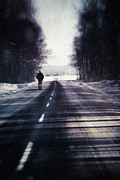 Mysterious Art - Man walking on a rural winter road by Sandra Cunningham