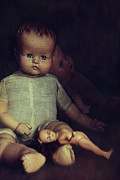 Porcelein Posters - Old dolls sitting on wooden table Poster by Sandra Cunningham
