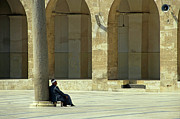 Mosque Photos - Man sitting inside the Great Mosque of Aleppo by Sami Sarkis
