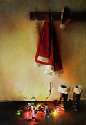 Rack Posters - Santa costume hanging on coat hook with Christmas lights Poster by Sandra Cunningham