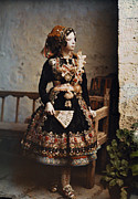 Portraits Photos - A Girl Poses In Her Traditional Costume by Gervais Courtellemont