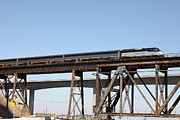 Wingsdomain Art and Photography - Amtrak Train Riding Atop The...